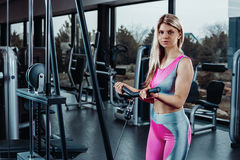 Woman at the gym exercising on a machine Stock Photography