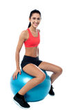 Woman in gym exercising with pilates ball Stock Images