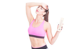 Woman at gym holding thermometer like summer heat. Isolated on white background with copy text space Stock Photo