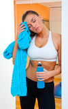 Woman in gym with isotonic bottle Stock Photography
