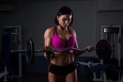 Woman in gym lifting weights royalty free stock photos