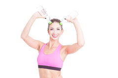 Woman at gym making horns with water bottles Stock Photos