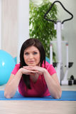 Woman on a gym mat Stock Photo