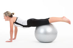 Woman in gym outfit exercising Stock Image