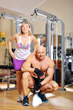 Woman in gym with personal trainer. Woman in gym with personal fitness trainer stock images
