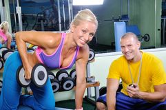 Woman in gym with personal trainer Royalty Free Stock Photography