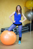 Woman at the gym with a pilates ball Royalty Free Stock Image