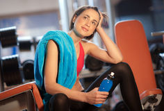 Woman in gym relaxing Royalty Free Stock Images