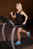 Woman gym running Stock Photos