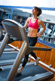 Woman in gym running on track Stock Photos