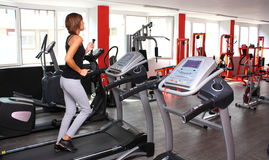 Woman in gym. Running on a treadmill Royalty Free Stock Photos