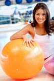 Woman at the gym smiling Royalty Free Stock Image