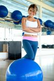 Woman at the gym smiling Royalty Free Stock Photo