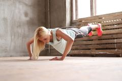 Woman in gym. Sport and exercise. Beautiful woman in gym royalty free stock photography