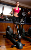 Woman in gym on stepper Royalty Free Stock Images