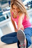 Woman at the gym stretching Royalty Free Stock Photos