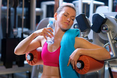Woman in gym with water bottle Royalty Free Stock Photography