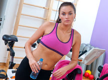 Woman in gym with water bottle Stock Image