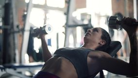 Woman on the gym. Those weights are too heavy stock video footage