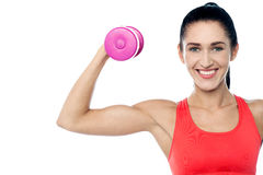 Woman in gym working out with dumbbell Royalty Free Stock Photos
