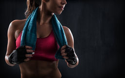 Woman after gym workout. Sexy muscular woman after workout with gym towel Stock Photo