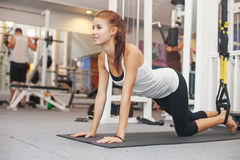 Woman in gym. Young beautiful woman in the gym Royalty Free Stock Photos