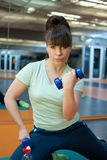 Woman in gym. Young woman do fitness exercise Royalty Free Stock Images