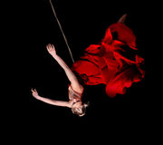 Woman gymnast in red dress on rope Royalty Free Stock Image