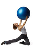 Woman with gymnastic ball. Young  beautiful woman with gymnastic ball on a white background Royalty Free Stock Image