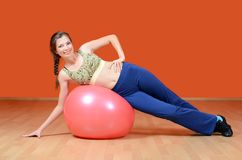 The woman with a gymnastic ball Royalty Free Stock Photography