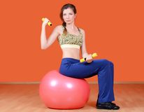 The woman with a gymnastic ball Stock Photos