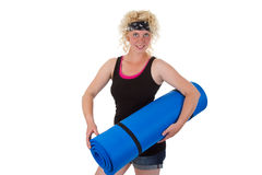 Woman with gymnastic mat Stock Photo