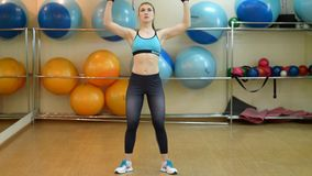 Young girl athlete engaged in gym on the shells. stock video