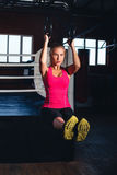 Woman on gymnastic rings Royalty Free Stock Photography