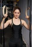 Woman with gymnastics rings Stock Photos