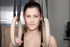 Woman with gymnastics rings looking at camera  fitness crossfit Royalty Free Stock Photos