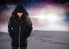 Woman hacker hooded standing on in front of digital background Stock Photo