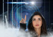 Woman hacker touching digital screens with her finger Royalty Free Stock Photography