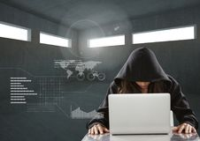 Woman hacker working on laptop in a  dark room. Digital composite of Woman hacker working on laptop in a  dark room Stock Photos