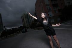 Woman hailing a cab Royalty Free Stock Photo