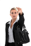 Woman hailing a cab Stock Images