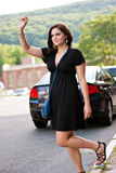 Woman Hailing a Taxi Cab Royalty Free Stock Photography