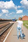 Woman hailing train Royalty Free Stock Photos