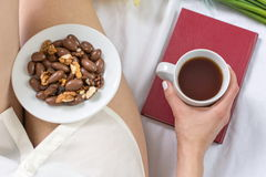 Woman haing a morning snack in bed Royalty Free Stock Photo