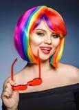 Woman hair as color splash. Rainbow up do short haircut. Beautif stock photography