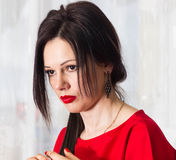Woman hair beauty portrait. Red dress. Close up. Stock Photo