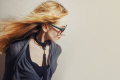 Woman with hair blowing in wind Royalty Free Stock Photos