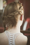Woman hair with braid closeup back view. Blonde woman hair with braid closeup back view Royalty Free Stock Image