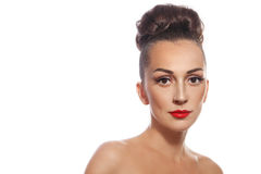 Woman with hair bun. Young slim attractive woman with stylish hair bun and red lipstick over white background stock photography
