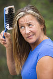 Woman Hair care with dusty handbrush Stock Images